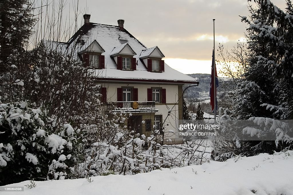 The flag of the Democratic Republic of Korea (DPRK - North Korea) flies at half-mast in front of the embassy in Muri bei Bern on December 19, 2011 . The new North Korean leader Kim Jong-Un had spent his youth in Switzerland and attended school near Berne, according to various unconfirmed source. On December 19, 2011 , the Swiss Foreign Ministry said being 'unable to comment on a possible link between Kim Jong-Un and Switzerland.' However, Swiss and foreign media reported that the young North Korean allegedly attended a private primary school, the International School of Bern in Guemligen, then a public school in Liebefeld, near Berne. AFP PHOTO / FABRICE COFFRINI