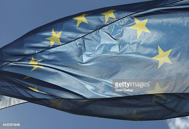 The flag of the European Union flies at the Chancellery on June 27 2016 in Berlin Germany German Chancellor Angela Merkel is scheduled to receive...
