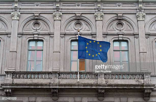 The flag of the European Union flies from the European Parliament information office in the European Quarter on February 25 2016 in Brussels Belgium...