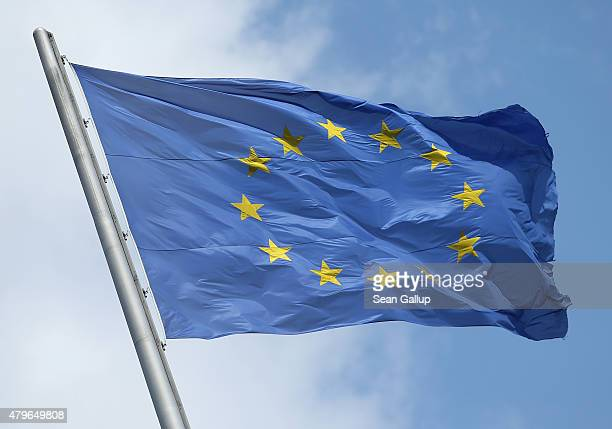The flag of the European Union flies over the Reichstag the day after a majority of people voted 'no' in the Greek referendum on July 6 2015 in...