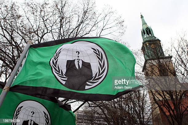 The flag of the hacker group Anonymous flies during a demonstration against the AntiCounterfeiting Trade Agreement on February 25 2012 in Berlin...
