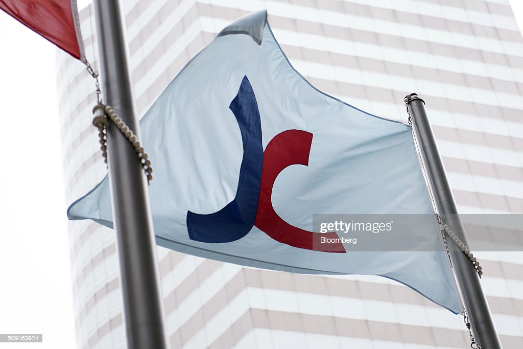The flag of the Hong Kong Exchanges and Clearing Ltd. (HKEx), fly in the Central district of Hong Kong, China, on Thursday, Feb. 11, 2016. Hong Kong stocks headed for their worst start to a lunar new year since 1994 as a global equity rout deepened amid concern over the strength of the world economy. Photographer: Xaume Olleros/Bloomberg via Getty Images