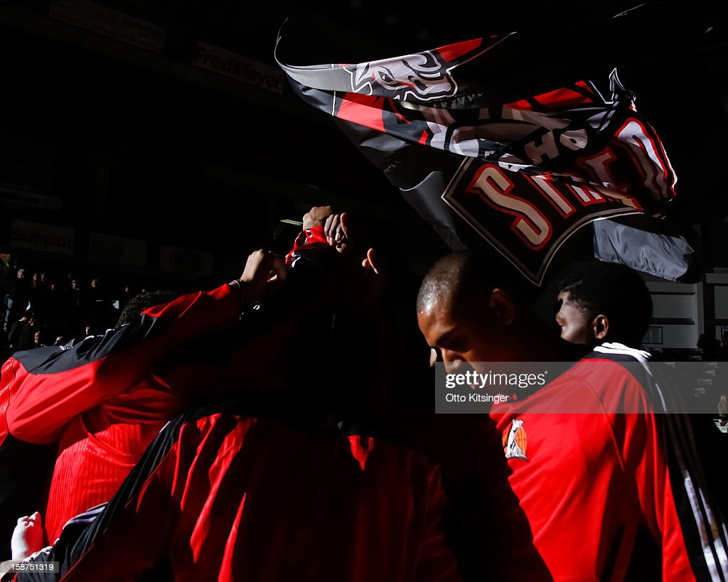 The flag of the Idaho Stampede is waved on court over the Stampede's huddle before the NBA D-League game against the Maine Red Claws on December 26, 2012 at CenturyLink Arena in Boise, Idaho.