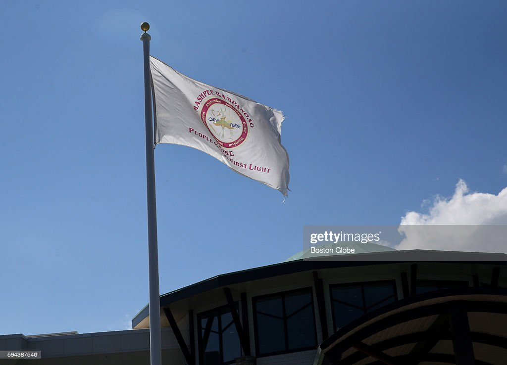 The flag of the Mashpee Wampanoag Native American tribe flies over the Mashpee Wampanoag Indian Council building in Mashpee Mass on August 2016
