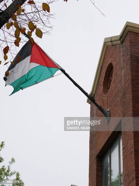 The flag of the Palestine Liberation Organisation is seen above its offices in Washington DC on November 18 2017 The Palestinians will freeze their...