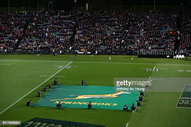 The flag of the Springboks is seen prior to the team lineups during the Rugby Championship match between the New Zealand All Blacks and the South...