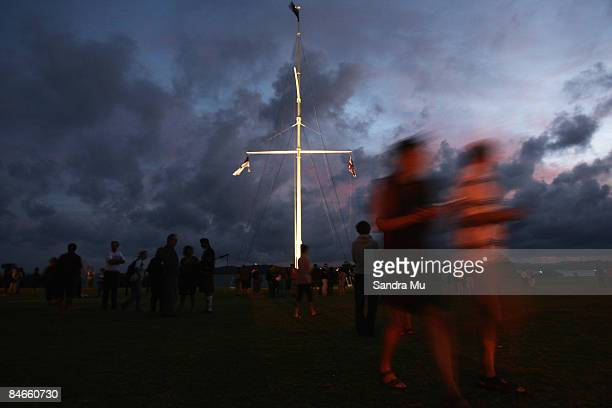 The flag pole is illuminated during the dawn service at the Upper Marae on the Treaty Grounds on February 6 2009 in Waitangi New Zealand Waitangi Day...