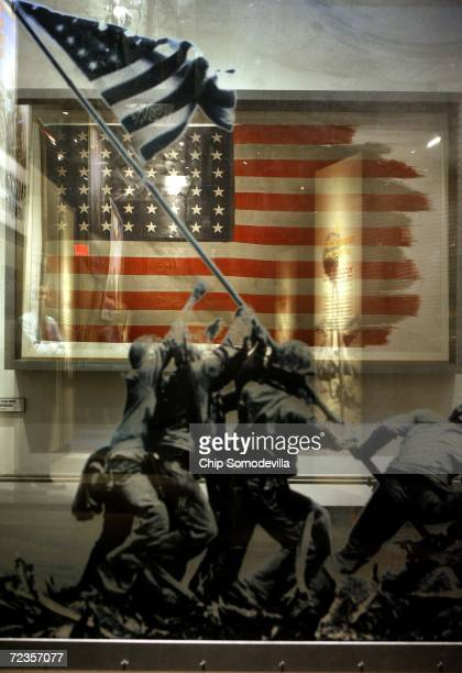 The flag raised during the WWII Battle of Iwo Jima and made famous by Associated Press photographer Joe Rosenthal is on display at the National...