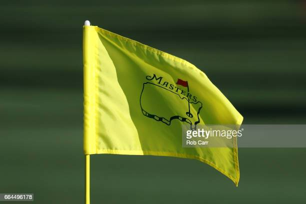 The flag waves in the breeze on the second hole during a practice round prior to the start of the 2017 Masters Tournament at Augusta National Golf...