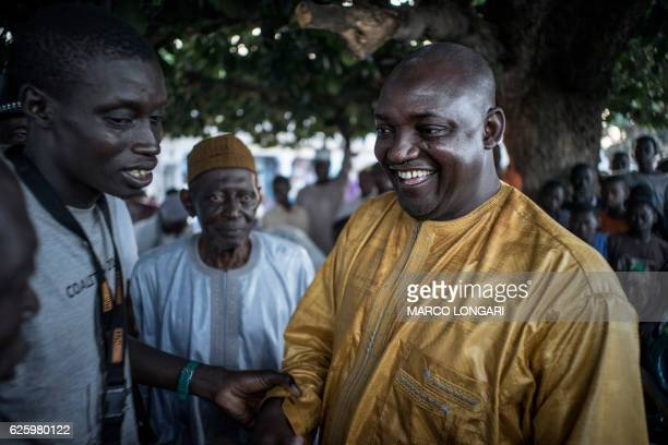 The flagbearer of the coalition of the seven opposition political parties in Gambia Adama Barrow is greeted by supporters at a gathering in Jambur on...