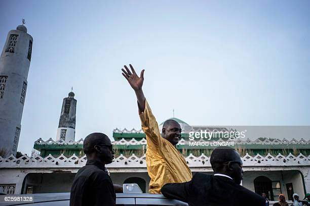 The flagbearer of the coalition of the seven opposition political parties in Gambia Adama Barrow greets supporters at a gathering in Jambur on...