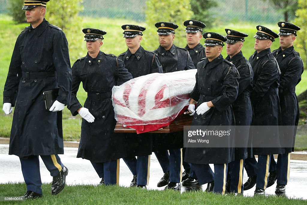 The flag-draped casket of Army Corporal David J. Wishon is carried to his final resting place by members of the Army's 3rd Infantry Regiment 'The Old Guard' during his burial at Arlington National Cemetery May 6, 2016 in Arlington, Virginia. Corporal Wishon was assigned to a medical unit in the 7th Infantry Division when he went missing after an attack on Dec. 1, 1950 in the Korean War.