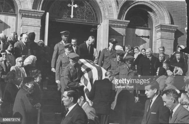 The flagdraped casket of Frank Macri Jr borne by Lowry airmen is Carried from Mt Carmel Catholic church Saturday following services for the three...