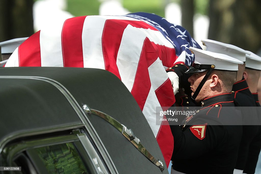 The flag-draped casket of Private First Class James Bernard Johnson is brough to his final resting place May 31, 2016 at Arlington National Cemetery in Arlington, Virginia. Johnson was assigned to Company K, 3rd Battalion, 8th Marines, 2nd Marine Division during WWII. He died sometime on the first day of battle against the Japanese, November 20, 1943, in an attempt to secure the small island of Betio in the Tarawa Atoll of the Gilbert Islands after landing.