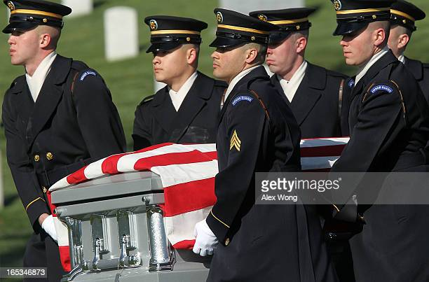 The flagdraped casket of US Army 1st Lt John E Terpning of Mount Prospect Illinois is carried to his final resting place by members of the Army's 3rd...