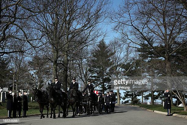 The flagdraped casket of US Army 1st Lt John E Terpning of Mount Prospect Illinois is escorted to his final resting place by members of the Army's...
