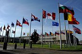 The flags are seen before a defence ministers meeting at the NATO headquarters in Brussels on October 22 2013 NATO defence ministers meet formally...