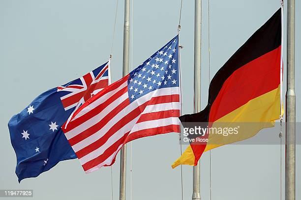 The flags of Australia the United States and Germany fly after the Team Open Water 5km medal ceremony during Day Six of the 14th FINA World...