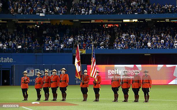 The flags of Canada and the United States are presented by members of the Royal Canadian Mounted Police before game two of the American League...