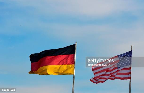 The flags of Germany and the US flutter at the Chancellery in Berlin where the German Chancellor is expected to meet the US President paying his...
