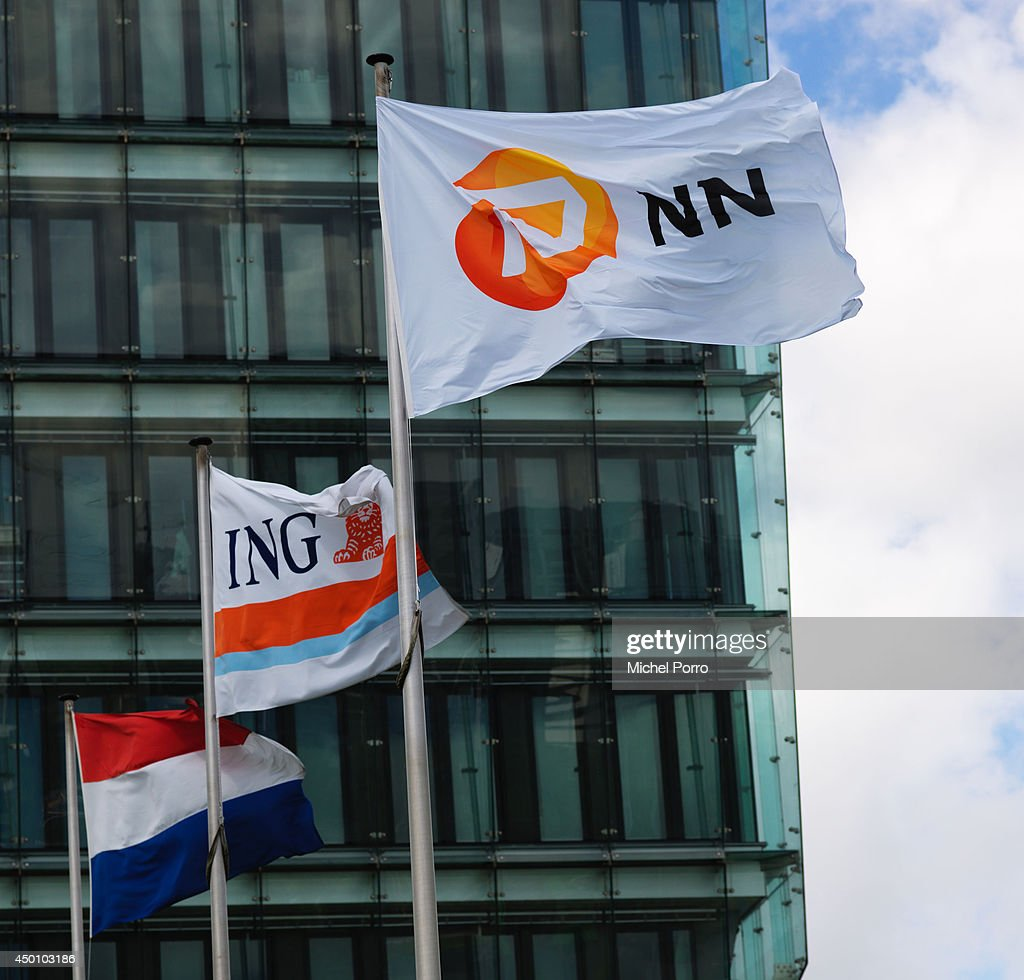 The flags of ING BANK and insurance company Nationale Nederlanden (NN) wave in front of the ING head offices on June 5, 2014 in Amsterdam, Netherlands. ING has officially announced its intention to start gradually selling off its NN Group (Nationale Nederlanden), the insurance subsidiary. ING aims to list its insurance arm within two months, in a deal that could be worth 8 billion euros.