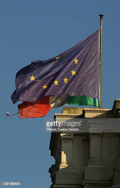 The flags of Italy and the European Union are displayed on November 17 2011 in Milan Italy Italy's new Prime Minister Mario Monti unveiled the...