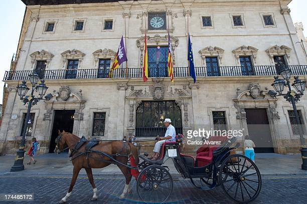 The flags of Mallorca Spain Balearic Islands and Europe flying at half mast at the town hall of Palma de Mallorca in honor of the victims of the...