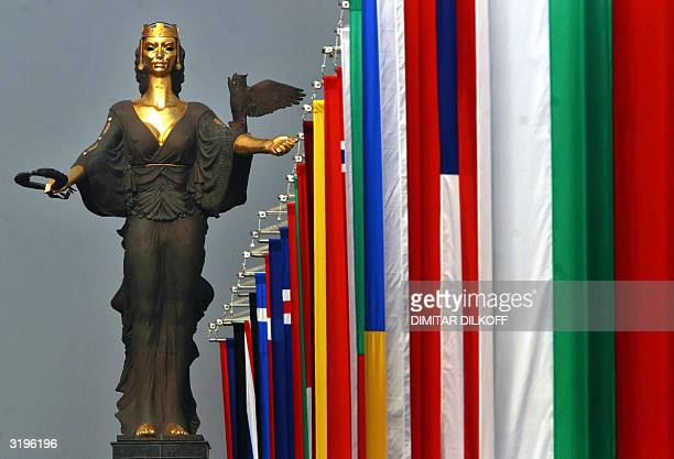 The flags of NATO member countries are raised in front of the statue of Saint Sofia during a ceremony marking the accession of Bulgaria and six other...