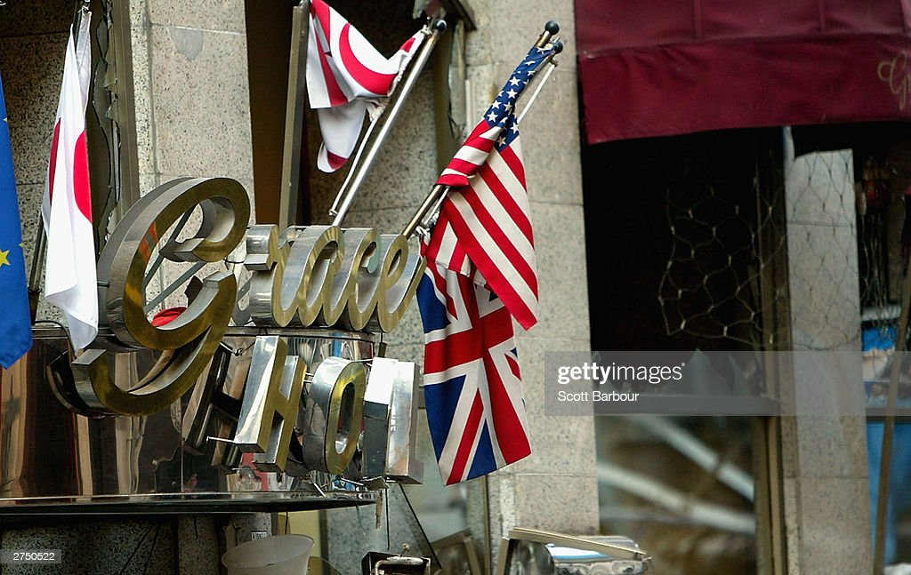 The flags of the United Kingdom and The United States of America are seen intertwined near the scene of the British Consulate bombing November 21, 2003 in Istanbul, Turkey. Bomb attacks on the British consulate and the HSBC bank headquarters on November 20, 2003 killed at least 27 people and left hundreds injured.