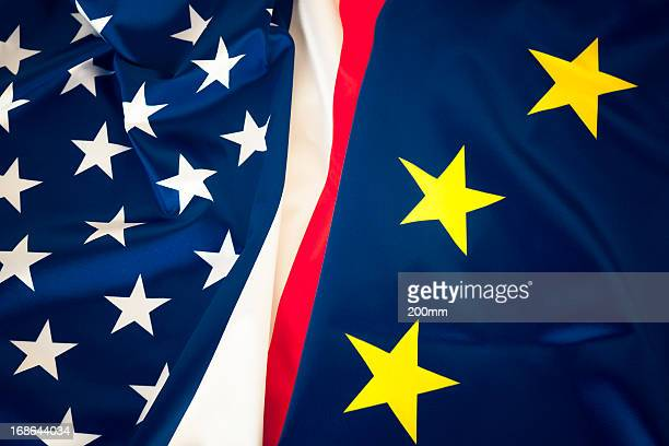 The flags of us-eu combined in a symbolic gesture of unity