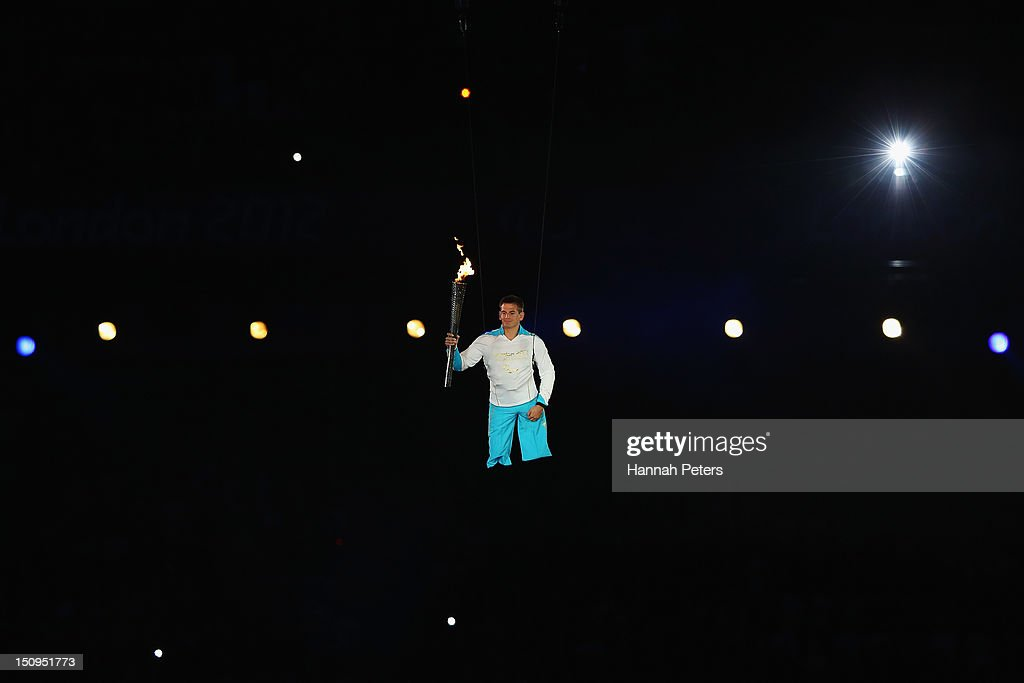 The flame is carried by Royal Marine Joe Townsend during the Opening Ceremony of the London 2012 Paralympics at the Olympic Stadium on August 29, 2012 in London, England.