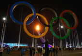 The flame is seen through the Olympic Rings after the Opening Ceremony of the Sochi 2014 Winter Olympics at Fisht Olympic Stadium on February 7 2014...