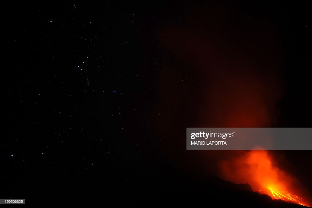 The flanks of the Stromboli volcano north of Sicily spews lava under the stars on January 14, 2013 after one of Europe's most active volanoes churned into activity. Stromboli, which attracts up to 6.000 tourists every year, had recently been placed under heightened surveillance after scientists registered higher seismic readings. AFP PHOTO/MARIO LAPORTA