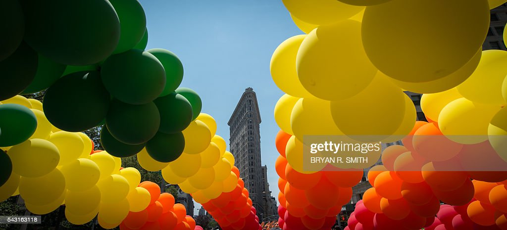 The Flatiron Building is seen behind rainbow balloons during the 46th annual Gay Pride march June 26, 2016 in New York. New York kicked off June 26 what organizers hope will be the city's largest ever Gay Pride march, honoring the 49 people killed in the Orlando nightclub massacre and celebrate tolerance. / AFP / the 46th / Bryan R. Smith
