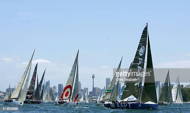 The fleet sails up Sydney Harbour during the start Rolex Sydney Hobart Yacht Race held on Sydney Harbour December 26 2004 in Sydney Australia