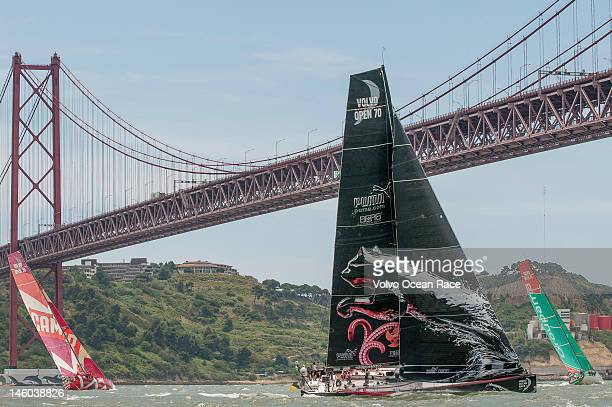The fleet split as they approach the 25 de Abril Bridge in the Oeiras InPort Race in Lisbon during the Volvo Ocean Race 201112