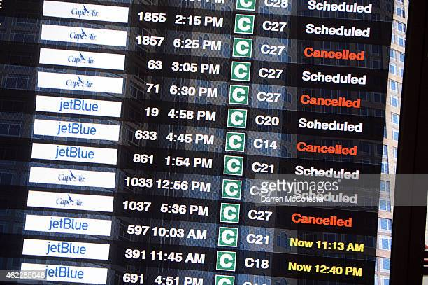 The flight board at Logan International Airport shows cancellations ahead of a massive winter storm January 26 2015 in Boston Massachusetts All...