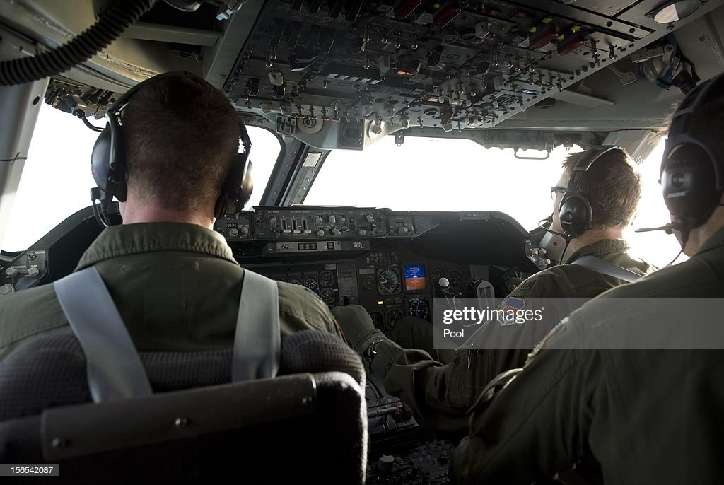 The flight crew of a Boeing E4-B airplane carrying US Secretary of Defense Leon Panetta are shown in the cockpit in flight over Alaska November 16, 2012. Panetta was concluding a six-day trip to Australia and Southeast Asia.