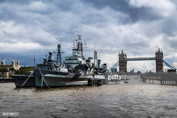 CONTENT] The floating Imperial War museum known as HMS Belfast moored in front of Tower Bridge on the banks of the River Thames in London