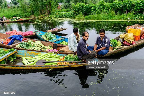 SRINAGAR JAMMU KASHMIR INDIA The 'Floating market' a vegetable market on Dal Lake where salesmen sell vegetables from shikara to shikara