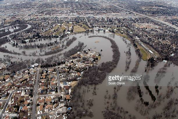 The flooded Red River separates Moorhead Minnesota from neighboring Fargo March 22 2010 in Fargo North Dakota Residents of Fargo neighboring Moorhead...