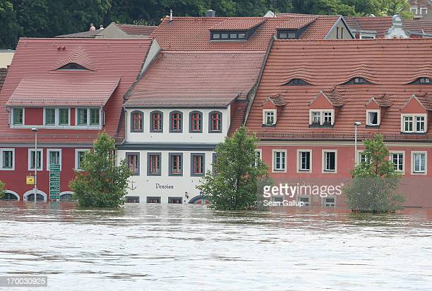 The flooding Elbe river churns past submerged houses in the historic city center on June 6 2013 in Meissen Germany Eastern and southern Germany are...