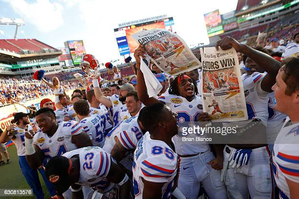 The Florida Gators celebrate their 303 win over the Iowa Hawkeyes at the conclusion of the Outback Bowl NCAA college football game on January 2 2017...