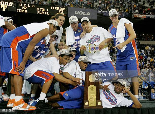 The Florida Gators celebrate with the trophy after defeating the UCLA Bruins 7357 during the National Championship game of the NCAA Men's Final Four...