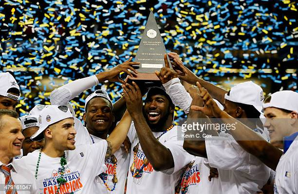 The Florida Gators celebrate with the trophy after their 61 to 60 win over the Kentucky Wildcats in the Championship game of the 2014 Men's SEC...