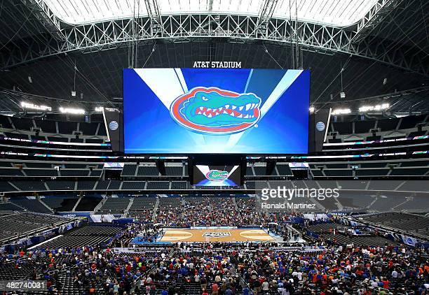 The Florida Gators logo is seen on the videoboard as the Gators practice ahead of the 2014 NCAA Men's Final Four at ATT Stadium on April 4 2014 in...