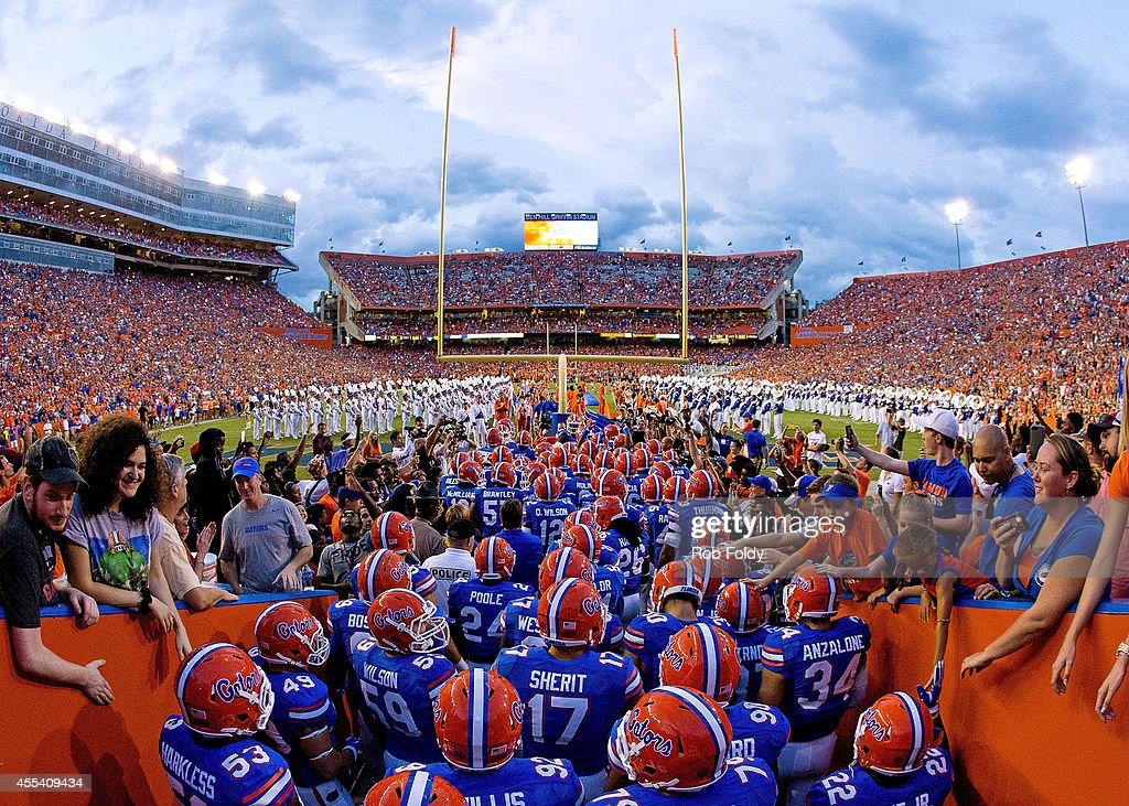 The Florida Gators take the field before the game against the Kentucky Wildcats at Ben Hill Griffin Stadium on September 13 2014 in Gainesville...