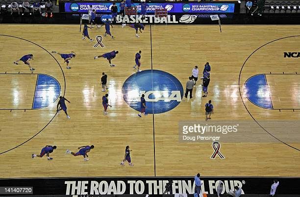 The Florida Gators warm up during practice as they prepare to the Virginia Cavaliers in the second round of the NCAA Men's Basketball Tournament at...