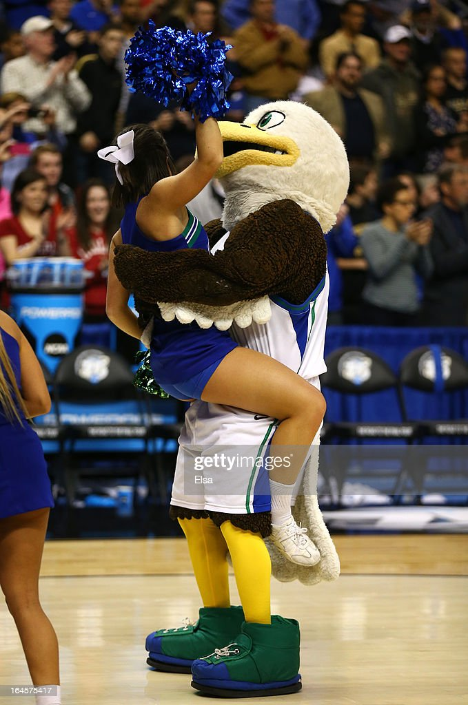 The Florida Gulf Coast Eagles mascot picks up an Eagles cheerleader after the Eagles 81-71 victory against the San Diego State Aztecs during the third round of the 2013 NCAA Men's Basketball Tournament at Wells Fargo Center on March 24, 2013 in Philadelphia, Pennsylvania.
