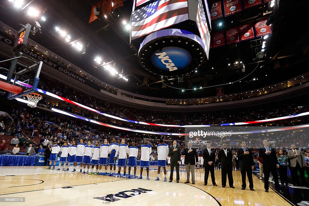 The Florida Gulf Coast Eagles stand during the national anthem before taking on the San Diego State Aztecs in the third round of the 2013 NCAA Men's Basketball Tournament at Wells Fargo Center on March 24, 2013 in Philadelphia, Pennsylvania.
